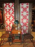 The Red & White Quilts on Display in the Shop