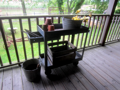 Idea for the industrial carts!  Great potting stand.